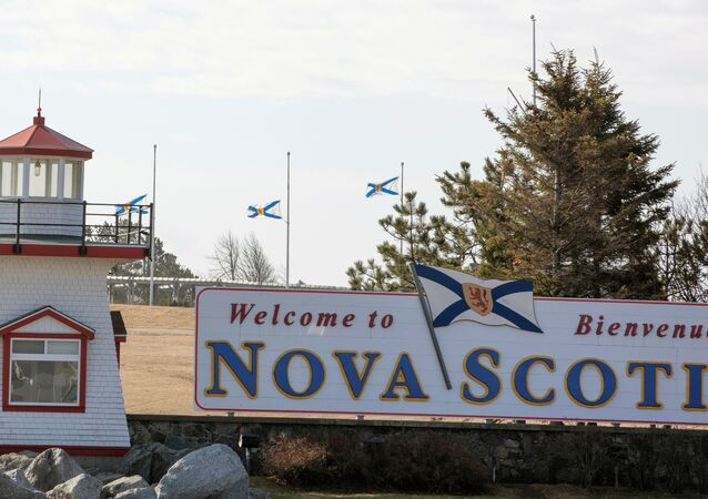 Nova Scotia flags are lowered on the New Brunswick/Nova Scotia border a day after a mass shooting by Gabriel Wortman, in Fort Lawrence, Canada April 20, 2020.