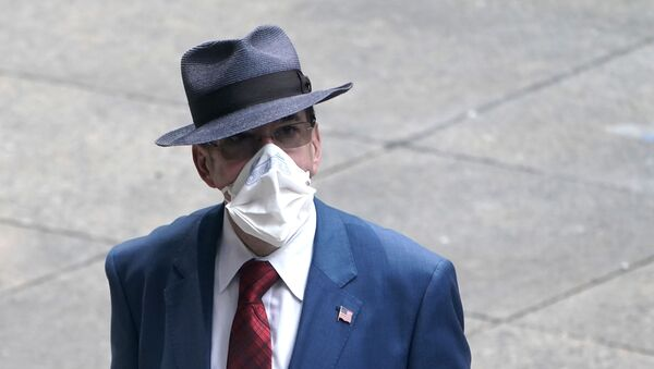 A man dressed in business attire wears a protective mask, following the outbreak of coronavirus disease (COVID-19) in the Manhattan borough of New York City, New York, U.S., July 23, 2020. - Sputnik International