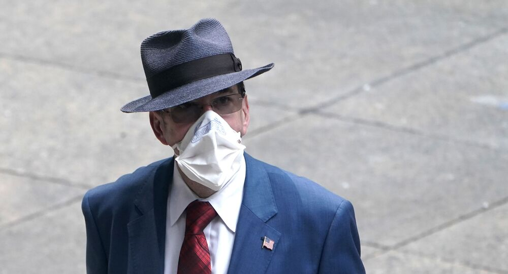 A man dressed in business attire wears a protective mask, following the outbreak of coronavirus disease (COVID-19) in the Manhattan borough of New York City, New York, U.S., July 23, 2020.