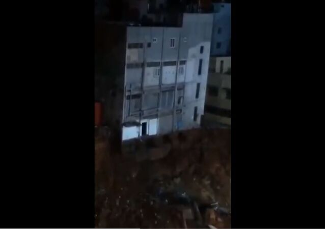 A four storeyed building behind Kapali Theatre in Bangalore collapses