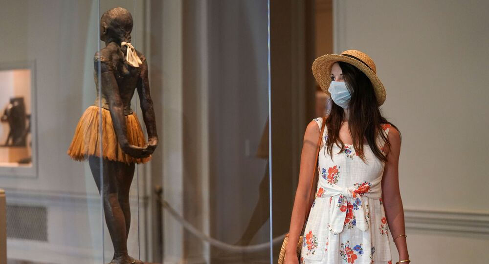 A visitor wearing her face mask looks at the Degas sculpture Little Dancer Aged Fourteen at the National Gallery of Art's West Building, which reopened today after months of  closure due to the coronavirus disease (COVID-19) outbreak, in Washington, U.S., July 20, 2020