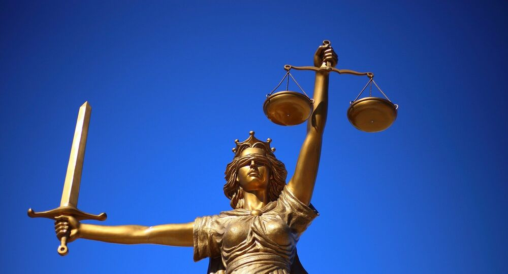 A figure holding the scales of justice