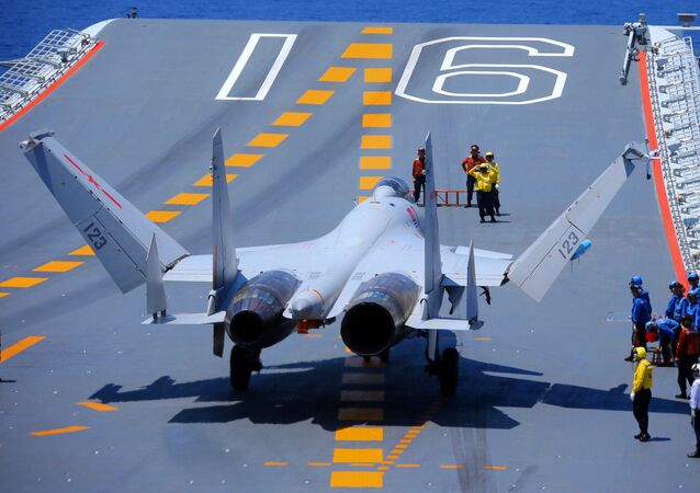 A J-15 fighter jet sits on the flight deck of the aircraft carrier Liaoning (Hull 16)