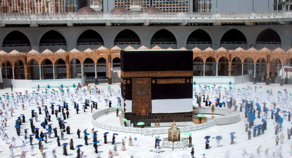 Muslim pilgrims maintain social distancing as they circle the Kaaba at the Grand mosque during the annual Haj pilgrimage amid the coronavirus disease (COVID-19) pandemic, in the holy city of Mecca, Saudi Arabia July 29, 2020.