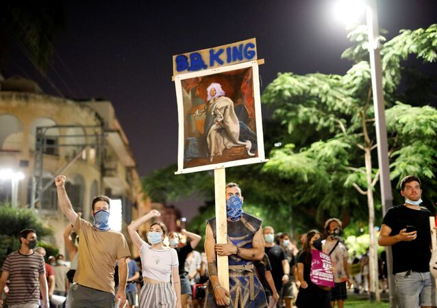 Israelis demonstrate against Prime Minister Benjamin Netanyahu and his government's handling of the coronavirus disease (COVID-19) crisis, on the main boulevard of Tel Aviv, Israel July 18, 2020
