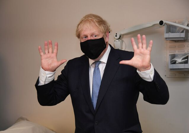 Britain's Prime Minister Boris Johnson visits the Tollgate Medical Centre in Beckton, London, Britain July 24, 2020.