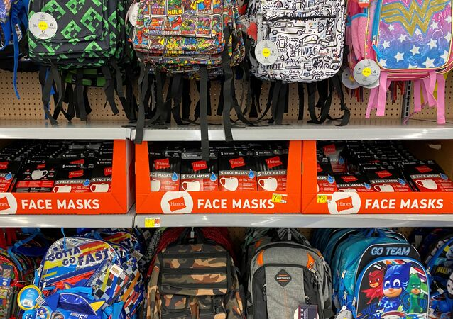 Face masks are shown for sale with back packs and back to school supplies at a Walmart store during the outbreak of the coronavirus disease (COVID-19) in Encinitas, California, U.S., July 28, 2020