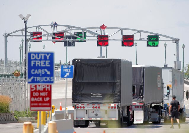 Trucks prepare to cross The Peace Bridge, which runs between Canada and the United States, over the Niagara River in Buffalo, New York, U.S. July 15, 2020.