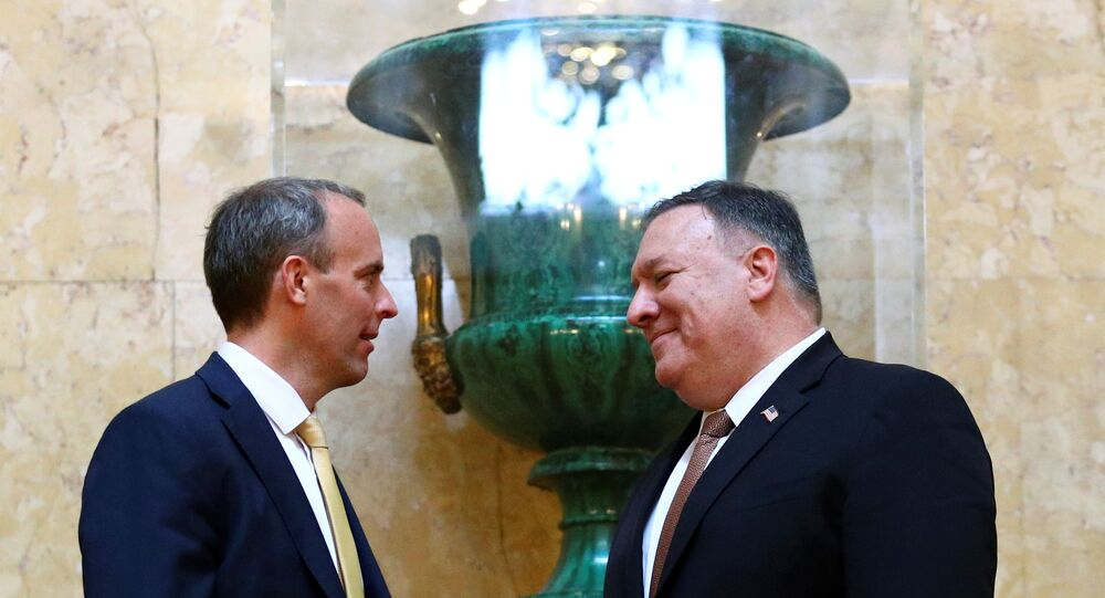US Secretary of State Mike Pompeo and Britain's Foreign Secretary Dominic Raab speak at Lancaster House in London, Britain, 21 July 2020