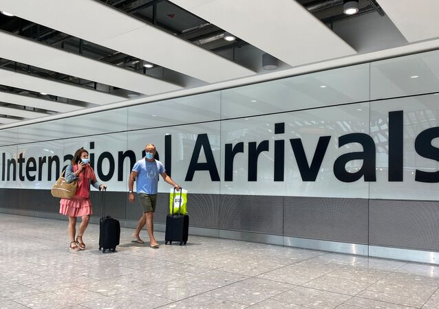 Passengers from international flights arrive at Heathrow Airport, following the outbreak of the coronavirus disease (COVID-19), London, Britain, July 29, 2020.