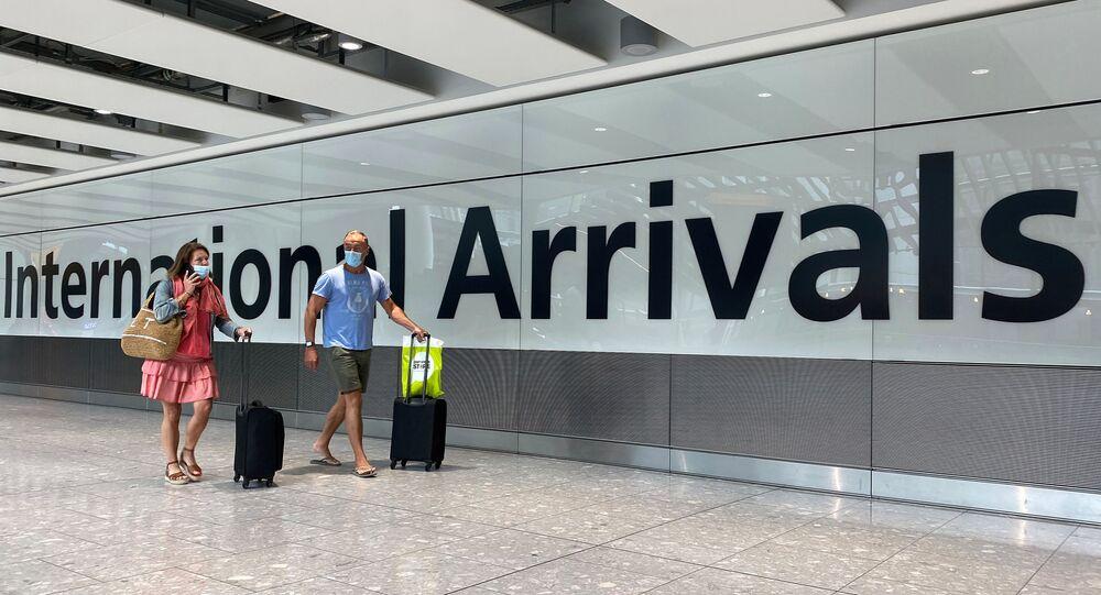 Passengers from international flights arrive at Heathrow Airport, following the outbreak of the coronavirus disease (COVID-19), London, Britain, July 29, 2020.