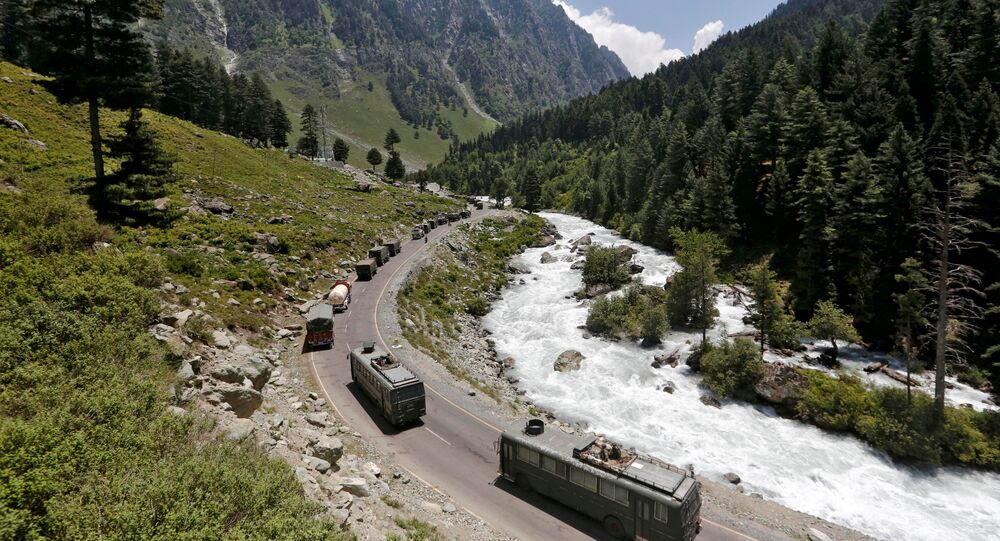 FILE PHOTO: An Indian Army convoy moves along a highway leading to Ladakh, at Gagangeer in Kashmir's Ganderbal district on June 18, 2020.