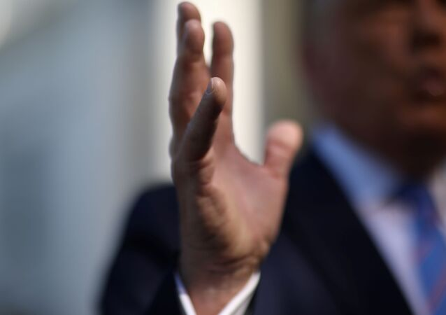 U.S. President Donald Trump speaks to the news media before departing on Marine One for travel to Midland, Texas from the South Lawn of the White House in Washington, U.S., July 29, 2020