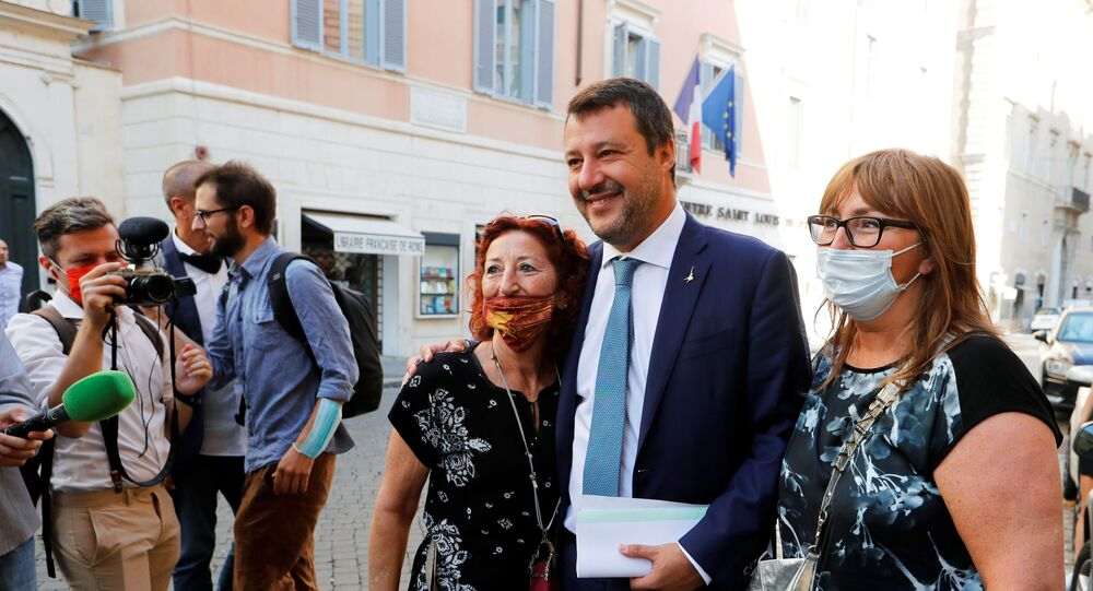 Leader of Italy's League party Matteo Salvini poses with supporters before addressing the upper house of parliament ahead of a vote by senators on whether to allow magistrates to investigate him for refusing a migrant rescue boat permission to land last year when he was interior minister, in Rome, Italy, July 30, 2020.