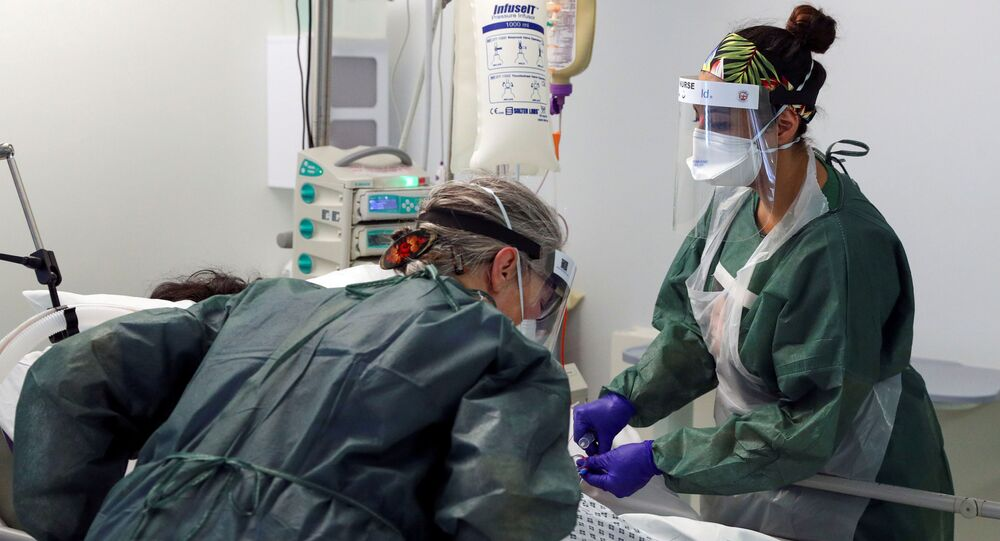 Nurses care for a patient in an Intensive Care ward treating victims of the coronavirus disease (COVID-19) in Frimley Park Hospital in Surrey, Britain, May 22, 2020