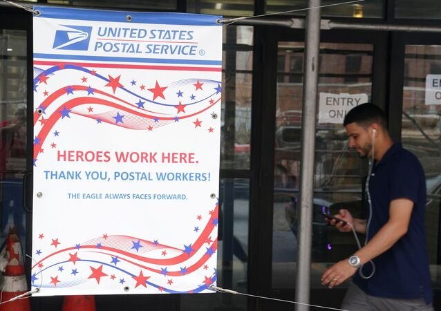 A man walks past a U.S. Postal Service building in the Manhattan borough of New York City, New York, U.S., July 30, 2020.
