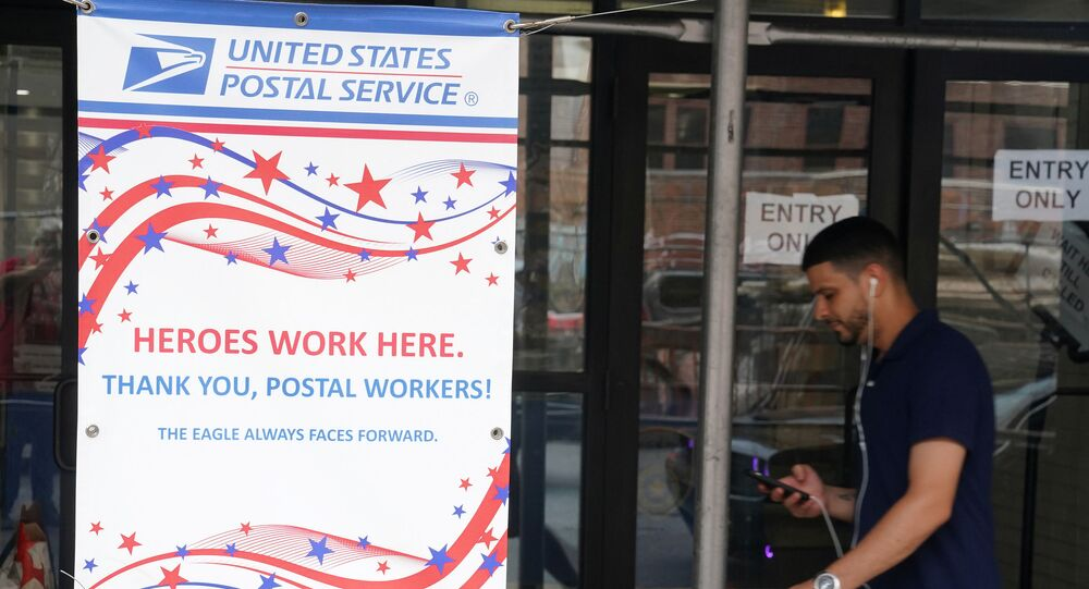 A man walks past a US Postal Service building in the Manhattan borough of New York City, 30 July 2020.