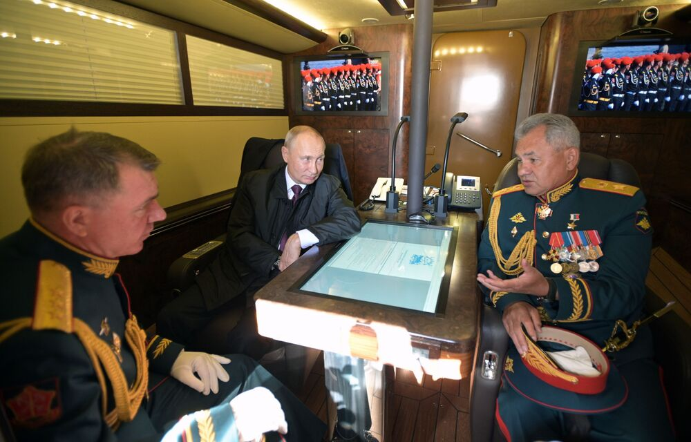 Russian President, Supreme Commander-in-Chief Vladimir Putin, Russian Defence Minister Sergei Shoigu (right) and Commander of the Western Military District Alexander Zhuravlev (left) in the cabin of the presidential boat during the transition to the water area of the Gulf of Finland.