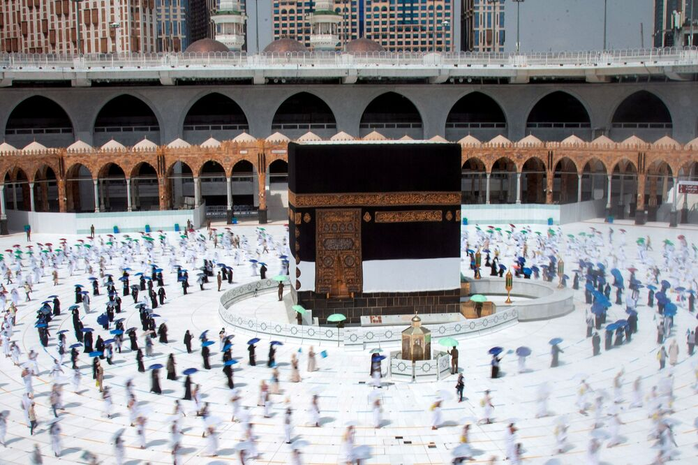 Muslim pilgrims maintain social distancing as they circle the Kaaba at the Grand mosque during the annual Haj pilgrimage amid the coronavirus disease (COVID-19) pandemic, in the holy city of Mecca, Saudi Arabia 29 July 2020.