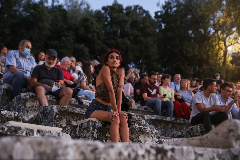 People wait for the start of The Persians, an ancient Greek drama by Aeschylus first performed in 472 BC, following the easing of measures against the spread of the coronavirus disease (COVID-19), at the ancient amphitheatre of Epidaurus, Greece, 24 July 2020.
