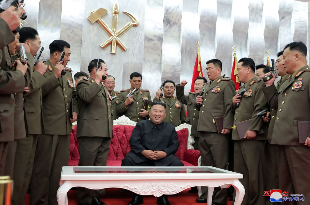 This picture taken on 26 July 2020 and released from North Korea's official Korean Central News Agency (KCNA) on 27 July shows North Korean leader Kim Jong Un (C) attending a ceremony to confer Paektusan commemorative pistols on leading commanding officers of DPRK armed forces on the occasion of the 67th anniversary of the Korean War ceasefire in Pyongyang.