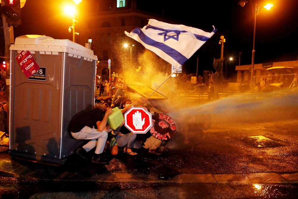 Police use water cannon during a protest against Israeli Prime Minister Benjamin Netanyahu's alleged corruption and his government's handling of the coronavirus disease (COVID-19) crisis, near his residence in Jerusalem 26 July 2020.