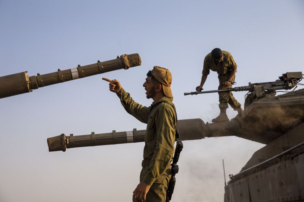 Israeli soldiers work on tanks in the Israeli-controlled Golan Heights near the border with Syria, not far from Lebanon's border, Tuesday, 28 July 2020. Lebanon's prime minister has accused Israel of provoking a dangerous escalation along the border in an attempt to modify the mandate of a U.N. peacekeeping force in south Lebanon.
