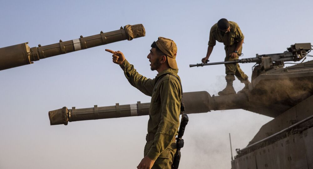 Israeli soldiers work on tanks in the Israeli controlled Golan Heights near the border with Syria, not far from Lebanon border, Tuesday, July 28, 2020.