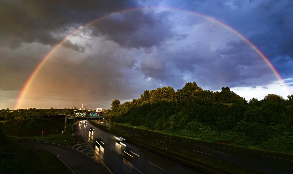 A rainbow and dark clouds are seen over the city of Dortmund, western Germany on 26 July 2020.