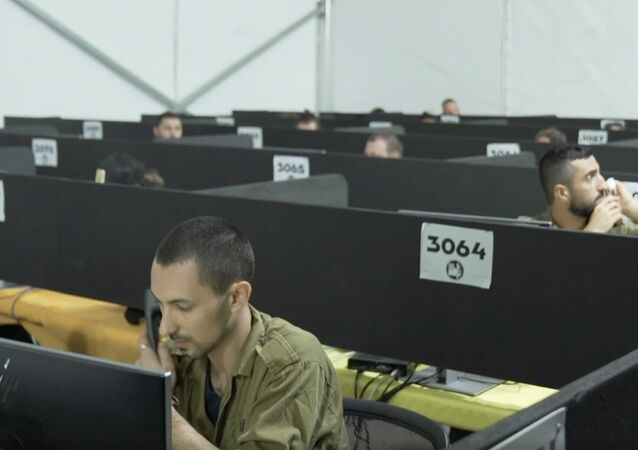 In a video released by the Israel Defence Forces on 29 July 2020, soldiers man the phones at the IDF Home Front Command's headquarters during a visit by coronavirus czar Prof. Ronni Gamzu