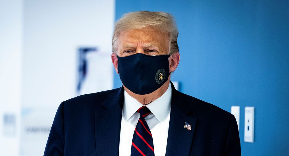 U.S. President Donald Trump wears a protective face mask as he watches as a patient donate plasma at the American Red Cross National Headquarters in Washington, U.S., July 30,  2020