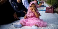 A muslim girl attends Eid al-Adha prayers at the Thai Islamic Center amid the spread of the coronavirus disease (COVID-19) in Bangkok, Thailand, 31 July 2020.