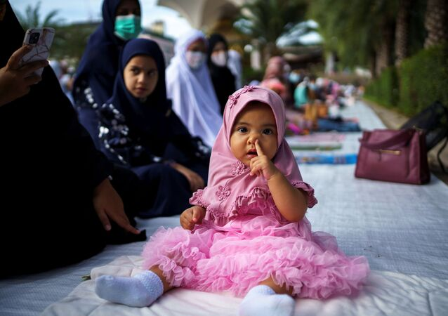 A muslim girl attends Eid al-Adha prayers at the Thai Islamic Center amid the spread of the coronavirus disease (COVID-19) in Bangkok, Thailand, 31 July 2020.