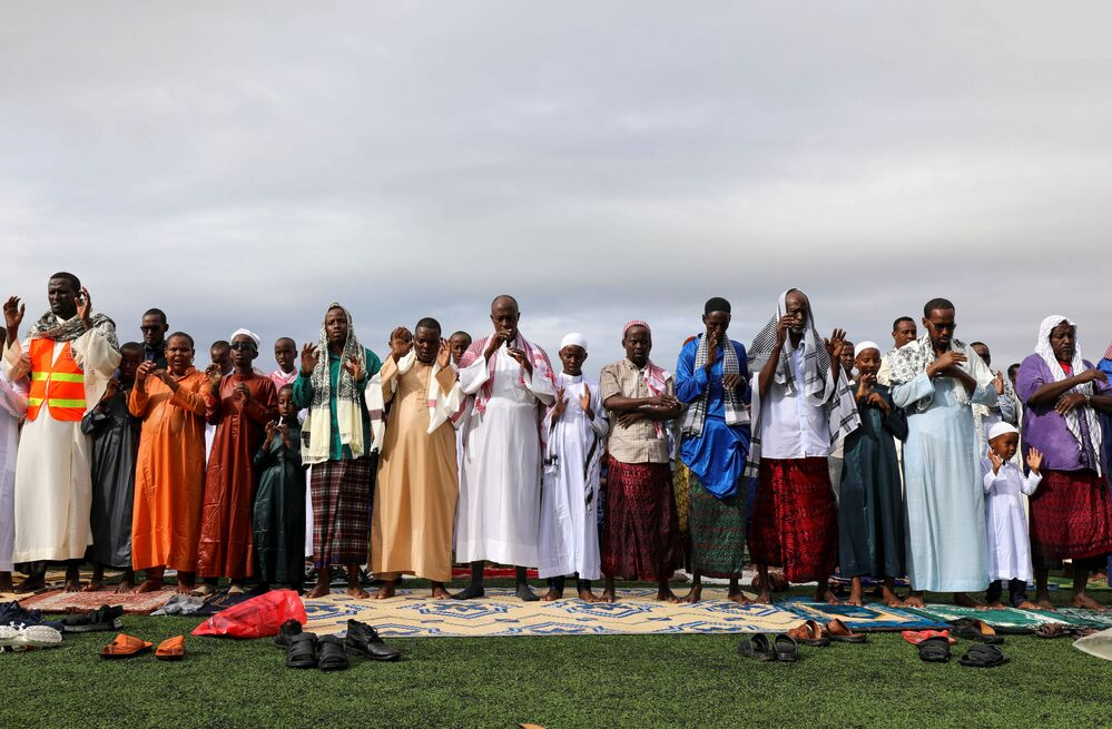 The Muslim faithful attend prayers to mark the holiday of Eid al-Adha amid the spread of the coronavirus disease (COVID-19), at the university football stadium in the Hodan district of Mogadishu, Somalia, 31 July 2020.
