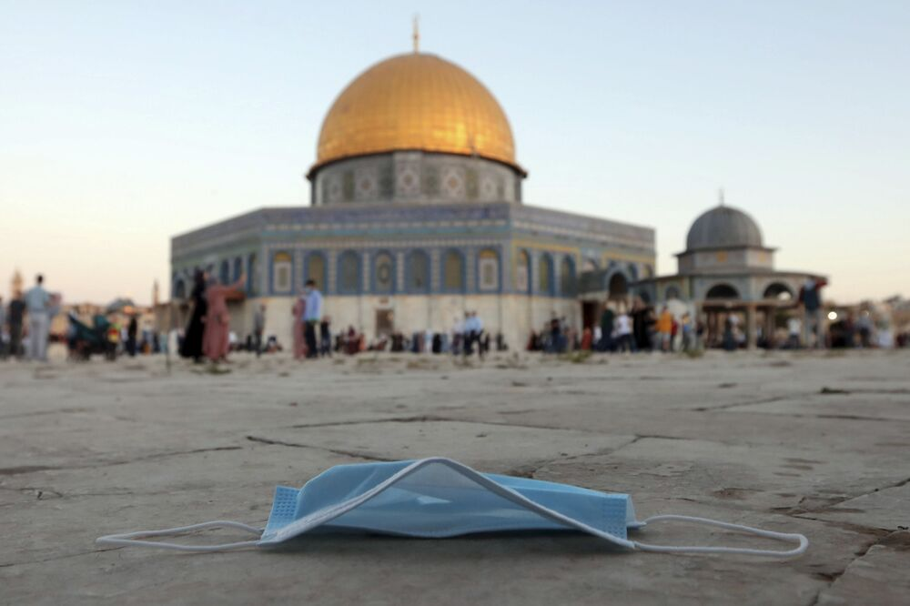 A protective face mask is thrown on the ground during an Eid al-Adha prayer, next to the Dome of the Rock Mosque in the Al Aqsa Mosque compound in Jerusalem's old city, Friday, 31 July 2020.