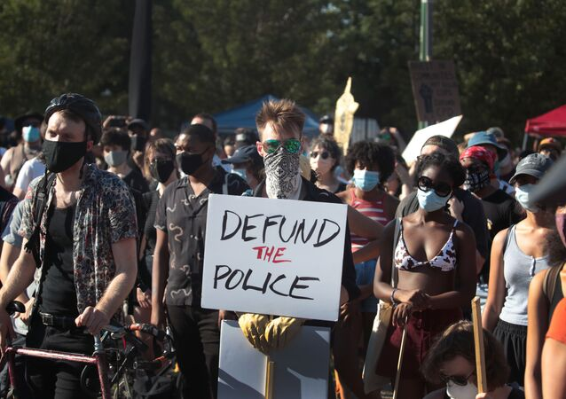 Activists hold a rally calling for the defunding of police in the Lawndale neighborhood on July 24, 2020 in Chicago, Illinois. The annual budget for the Chicago Police Department is more than $1.6 billion.