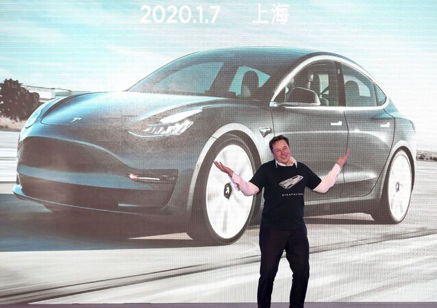 In this file photo taken on January 07, 2020 Tesla CEO Elon Musk gestures during the Tesla China-made Model 3 Delivery Ceremony in Shanghai.