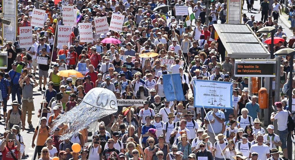 People attend a demonstration initiated by the initiative Querdenken-711 with the slogan the end of the pandemic-the day of freedom to protest against the current measurements to curb the COVID-19 spreading in Berlin, on August 1, 2020.