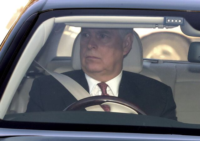 Britain's Prince Andrew drives into Buckingham Palace, as he arrives for the traditional Queen's Christmas lunch, in London
