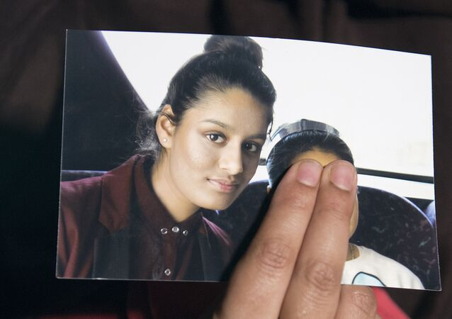 In this file photo taken on February 22, 2015 Renu, eldest sister of missing British girl Shamima Begum, holds a picture of her sister while being interviewed by the media in central London, on February 22, 2015