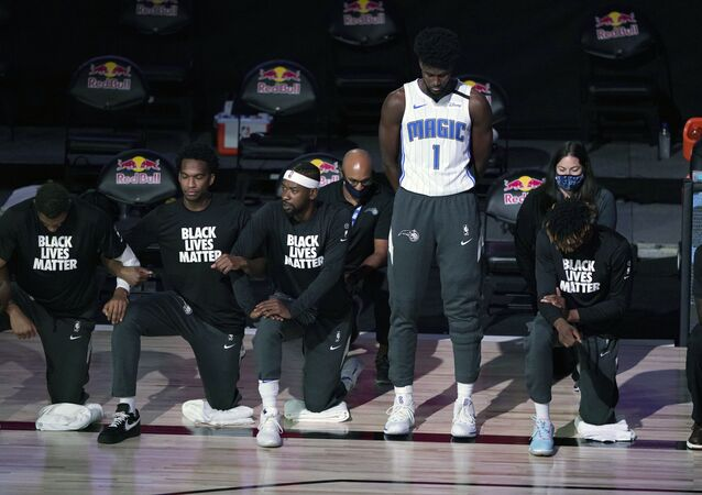 NBA Player Jonathan Issac Stands During National Anthem Photo