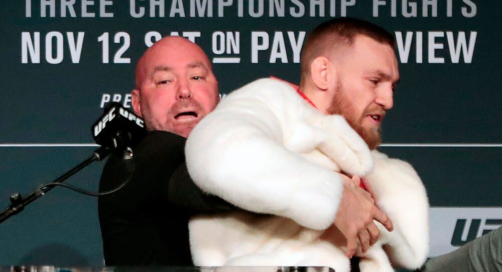 In this Nov. 10, 2016, file photo, fighter Conor McGregor, right, is restrained by UFC president Dana White during a news conference ahead of the UFC 205 mixed martial arts fight between McGregor and Eddie Alvarez, not shown, at Madison Square Garden in New York.