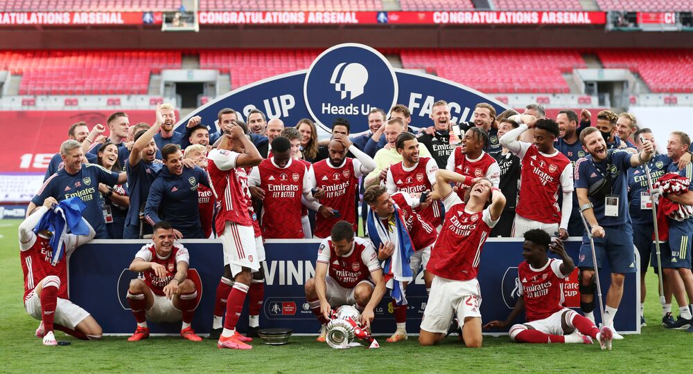Arsenal's Pierre-Emerick Aubameyang reacts after dropping the trophy after winning the FA Cup