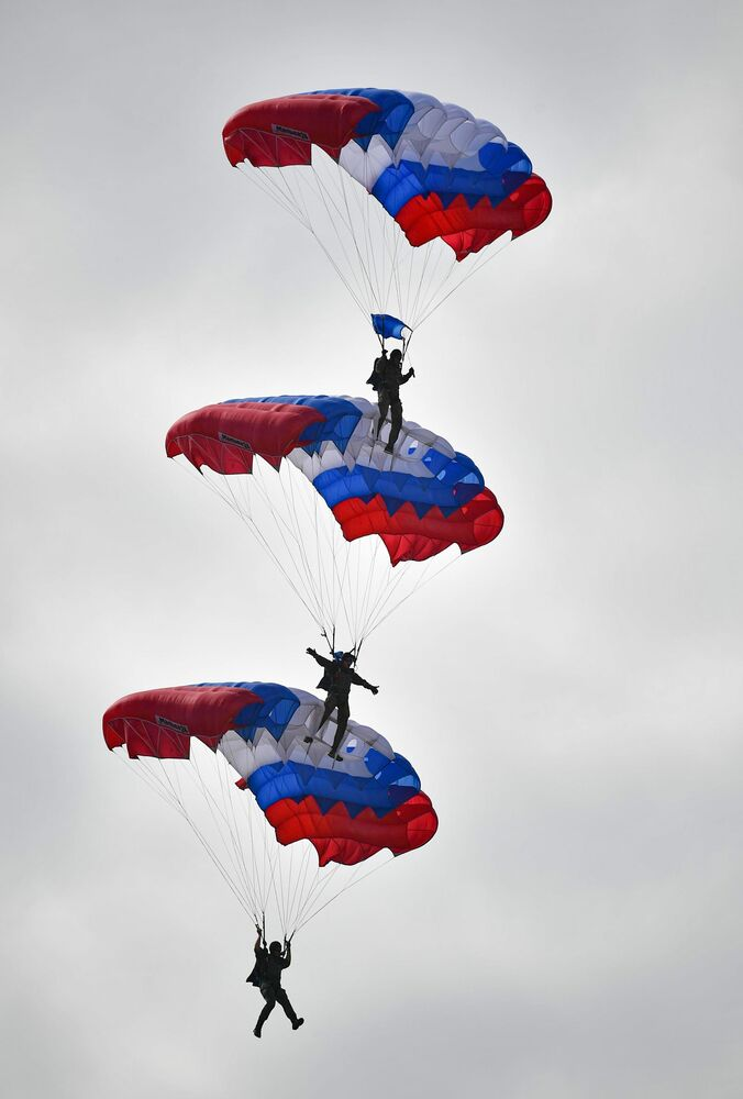 Parachuting demonstrations during a military-sports holiday honouring of the Airborne Forces at Alabino training ground.