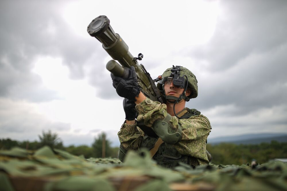 A serviceman with an Igla portable anti-aircraft missile system at a demonstration performance in honour of the Airborne Forces Day at the Raevsky training ground in Krasnodar Territory.