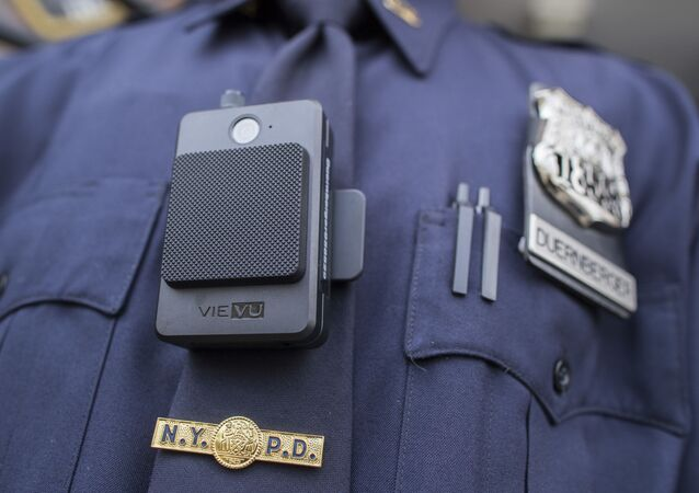 A police officer wears a newly issued body camera outside the 34th precinct, Thursday, April 27, 2017, in New York. The New York Police Department is launching the first phase of a plan to equip 22,000 officers with body cameras