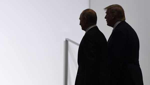 President Donald Trump and Russian President Vladimir Putin walk to participate in a group photo at the G20 summit in Osaka, Japan, Friday, June 28, 2019 - Sputnik International