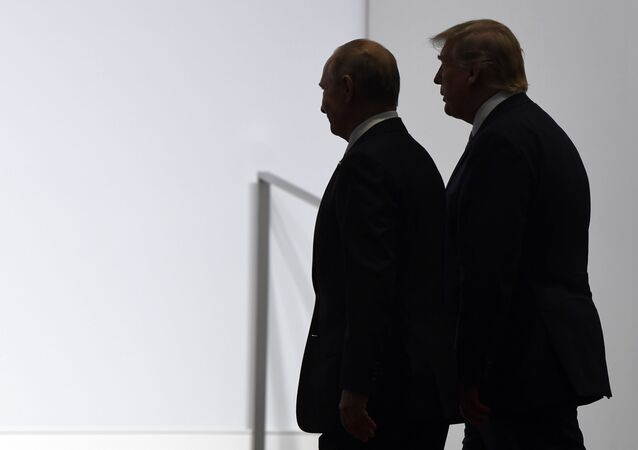 President Donald Trump and Russian President Vladimir Putin walk to participate in a group photo at the G20 summit in Osaka, Japan, Friday, June 28, 2019
