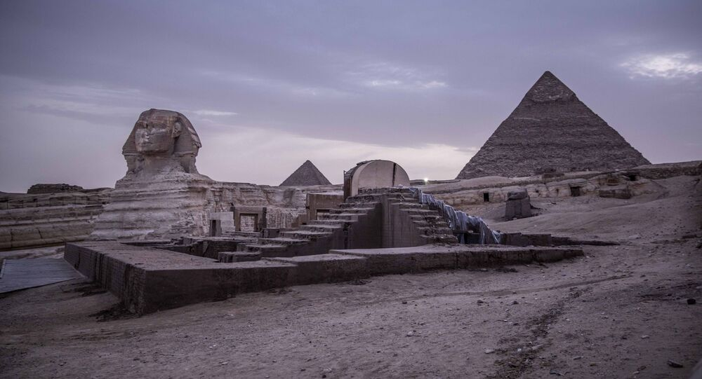 This March 30, 2020 file photo, shows the empty Giza Pyramids and Sphinx complex on lockdown due to the coronavirus outbreak in Egypt. In July, fearing further economic fallout, the government reopened much of society and welcomed hundreds of international tourists back to resorts, even as daily reported deaths exceeded 80. Restaurants and cafes are reopening with some continued restrictions, and masks have been mandated in public