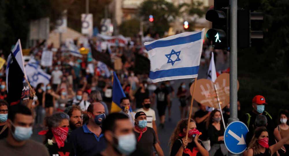 Israelis march as they protest against Israeli Prime Minister Benjamin Netanyahu and his government's response to the financial fallout of the coronavirus disease (COVID-19) crisis in Jerusalem July 21, 2020.